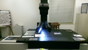 Cruse scanner, used by the Air Force Art Program for preservation. The tower in the back allows the scan to adjust for varying sizes of subjects, and the light bulbs used are custom made for the amount of use this particular scanner gets!